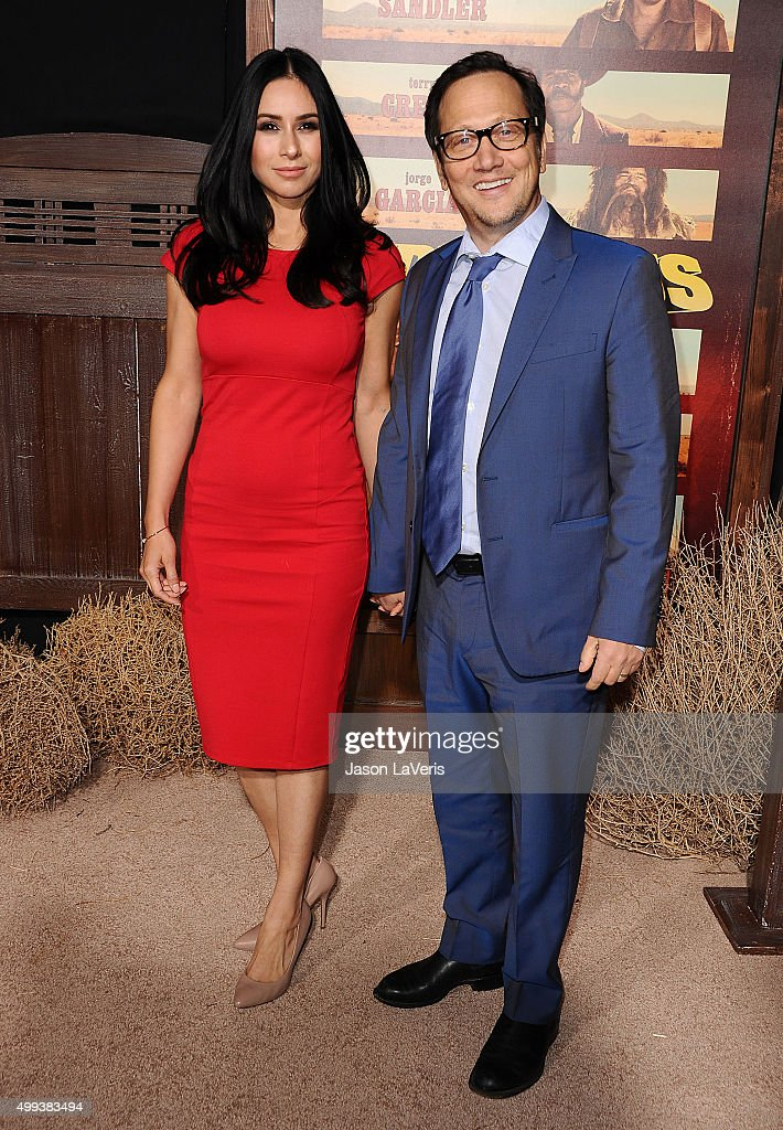Actor Rob Schneider (R) and wife Patricia Maya Schneider attend the premiere of 'The Ridiculous 6' at AMC Universal City Walk on November 30, 2015 in Universal City, California.