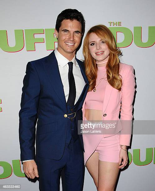 Actor Robbie Amell and actress Bella Thorne attend the premiere of The Duff at TCL Chinese 6 Theatres on February 12 2015 in Hollywood California