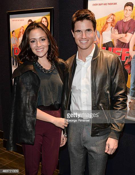 Actor Robbie Amell and fiancee Italia Ricci attend the Canadian Premiere of 'The Duff' at Cineplex Scotiabank Theatre on February 17 2015 in Toronto...