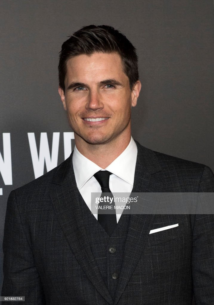 Actor Robbie Amell attends the Los Angeles special screening of Netflix's 'When We First Met,' on February 20, 2018, in Hollywood, California. /