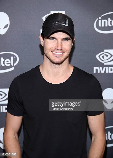 Actor Robbie Amell checks out the latest virtual reality and gaming technology at a VIP Alienware Party during E3 in partnership with NVIDIA and...