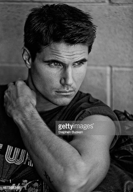 Actor Robbie Amell is photographed for Glamoholic on January 15 2015 in Hollywood California