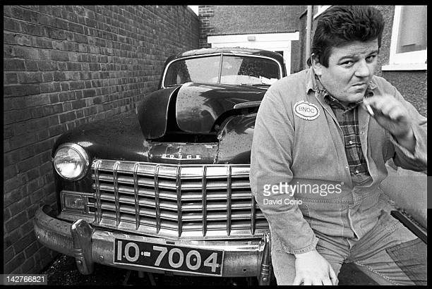 Actor Robbie Coltrane at his home in Kilburn with his Dodge car London 1980