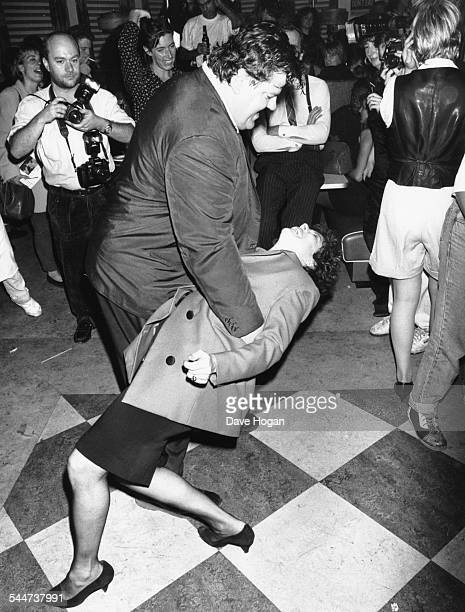 Actor Robbie Coltrane dancing with comedienne Ruby Wax on the dancefloor at a charity show London September 25th 1989