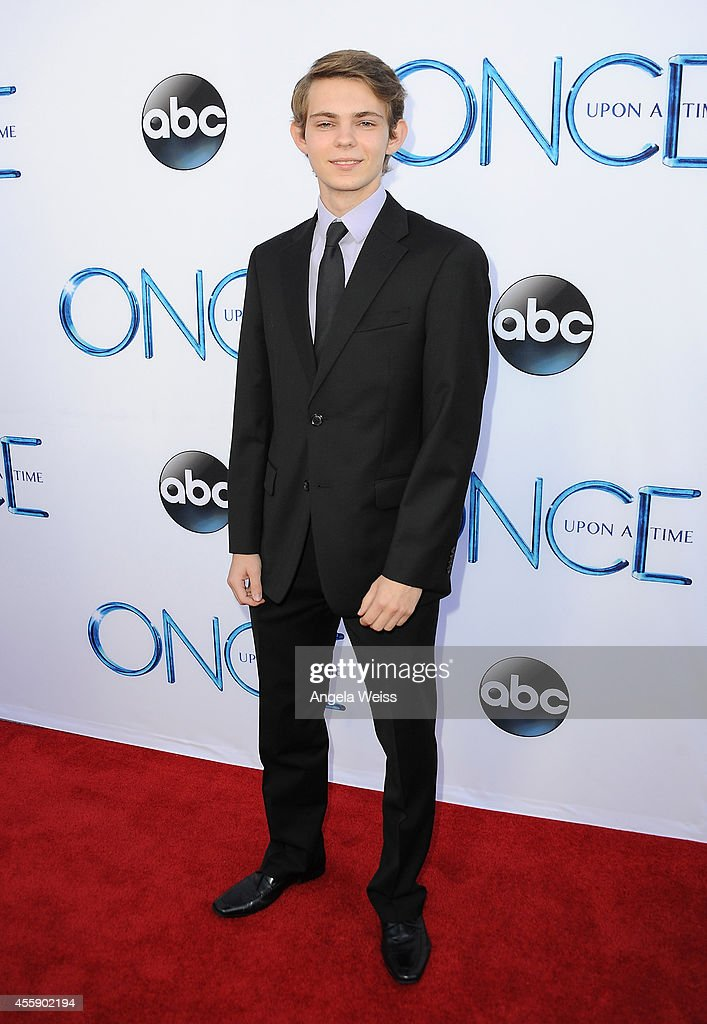 Actor Robbie Kay attends ABC's 'Once Upon A Time' Season 4 red carpet premiere at the El Capitan Theatre on September 21, 2014 in Hollywood, California.