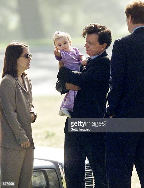 Actor Robert Blake holds Rose Lenore Sophie Blake the daughter he fathered with his slain wife Bonny Lee Bakley during a brief funeral ceremony for...