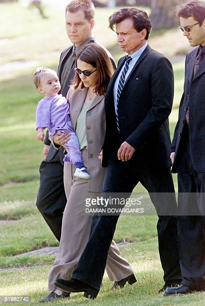 Actor Robert Blake walks to the gravesite of his slain wife Bonny Lee Bakley with his 11monthold daughter Delinah carrying the child he fathered with...