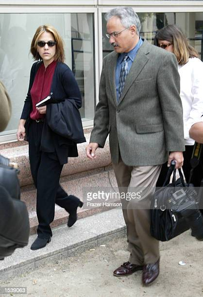 Actor Robert Blake's daughter Delinah Blake arrives for her father's hearing at the Van Nuys Superior Court with Scott Ross a private investigator...