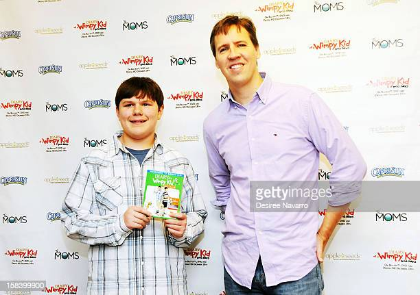 Actor Robert Capron and author Jeff Kinney attend Diary Of A Wimpy Kid Dog Days DVD Release Launch Event at apple seeds on December 15 2012 in New...