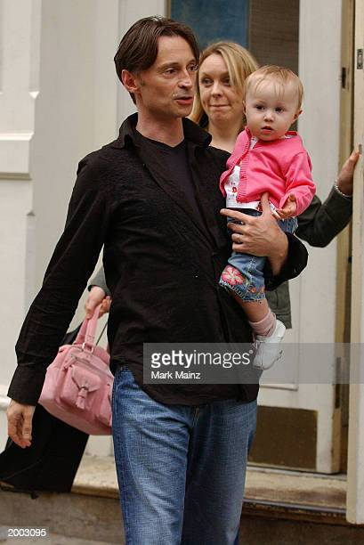 Actor Robert Carlyle with his wife Anastasia Shirley and daughter Ava go shoe shopping in the SoHo neighborhood May 15 2003 in New York City