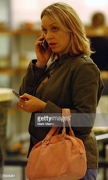 Actor Robert Carlyle's wife Anastasia Shirley talks on a cell phone while shoe shopping in the SoHo neighborhood May 15 2003 in New York City