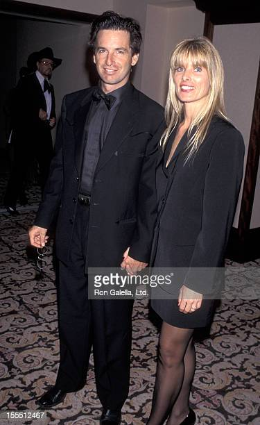 Actor Robert Carradine and wife Edie Mani attending 13th Annual Golden Boot Awards on August 12 1995 at Century Plaza Hotel in Century City California