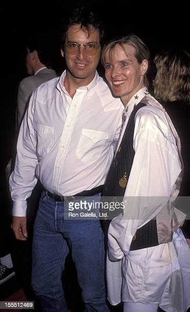 Actor Robert Carradine and wife Edie Mani attending the premiere of Sketch Artist on June 1 1992 at The Academy Theater in Beverly Hills California