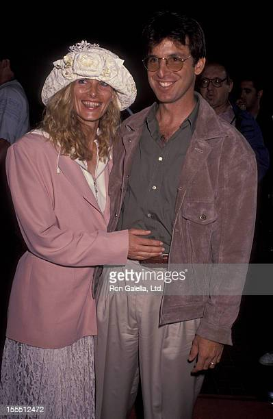 Actor Robert Carradine and wife Edie Mani attending the premiere of Point Break on July 10 1991 at Avco Cinema Center in Westwood California