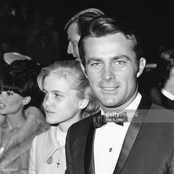 Actor Robert Conrad and his daughter Nancy attending an event in formal dress circa 1970