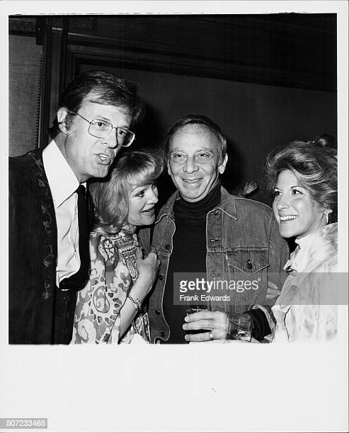 Actor Robert Culp and his wife with actor Norman Fell and his wife attending the 'roast' of stuntman Hal Needham Hollywood CA November 1975