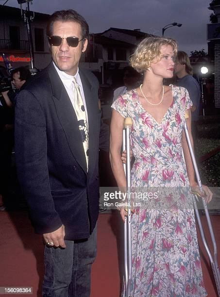 Actor Robert Davi and wife Christine Bolster attend the 'Lethal Weapon 3' Westwood Premiere on May 1 1992 at Mann Village Theatre in Westwood...