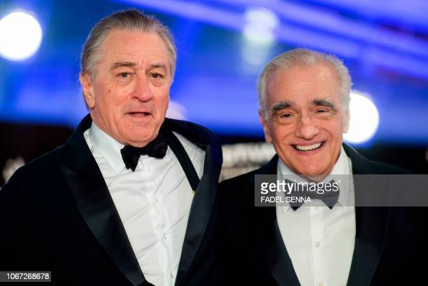 US actor Robert De Niro and US film director Martin Scorsese arrive at the Marrakech International Film festival on December 1 2018 in the city of...