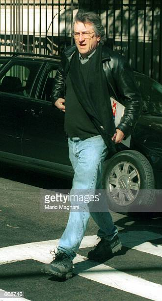 Actor Robert De Niro curses paparazzi October 31 2000 as he leaves Madonna's house on the West Side in New York City De Niro told paparazzi' to get a...