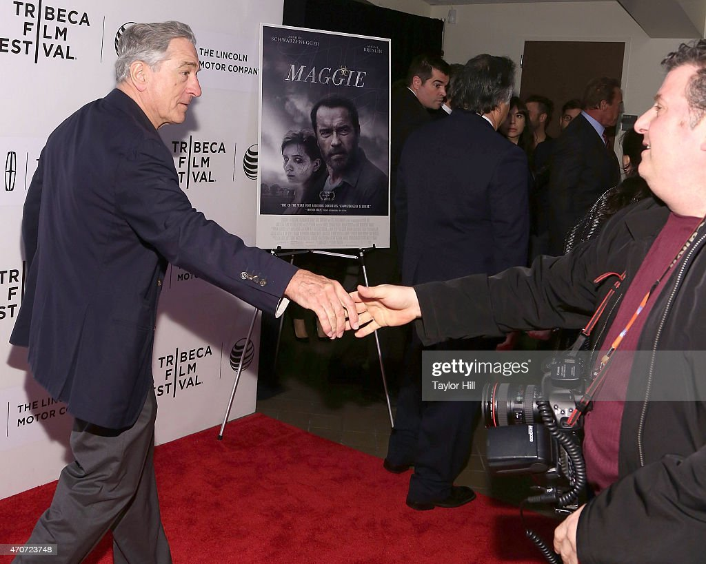 Actor Robert De Niro greets photographer Dave Allocca during the world premiere of 'Maggie' during the 2015 Tribeca Film Festival at BMCC Tribeca PAC on April 22, 2015 in New York City.
