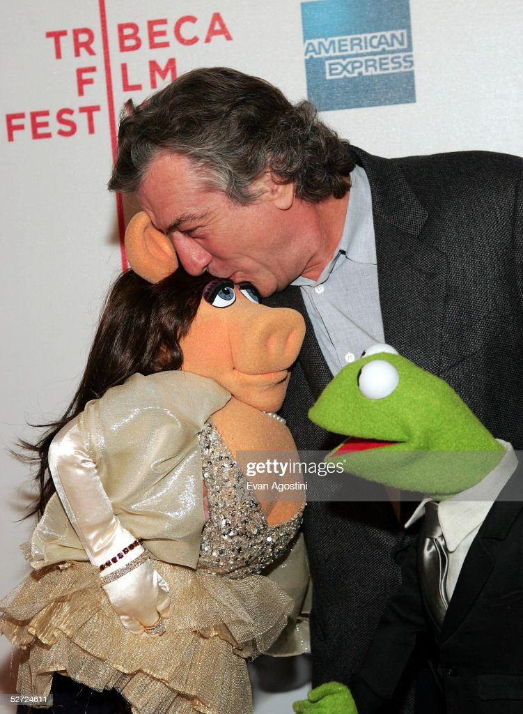 Actor Robert De Niro kisses Miss Piggy as Kermit The Frog looks on during the premiere of 'The Muppets Wizard of Oz' at the Tribeca FAMILY Festival. The FAMILY Street Fair will be this Saturday, April 30 from 10am to 6pm on Greenwich Street