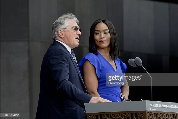Actor Robert De Niro left speaks as actress Angela Bassett listens at the opening ceremony of the Smithsonian's National Museum of African American...
