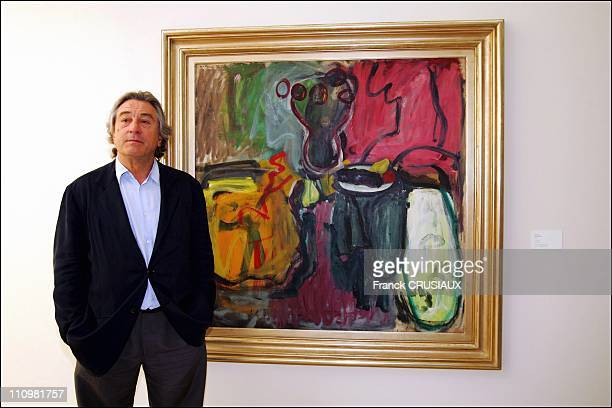 US actor Robert De Niro poses next to a painting by his father Robert Sr which was donated to La Piscine by the Salander O'Reilly gallery at the...