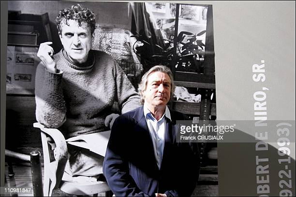 US actor Robert De Niro poses next to a portrait of his father Robert Sr in an exhibition of Robert De Niro Sr paintings at La Piscine in Roubaix...