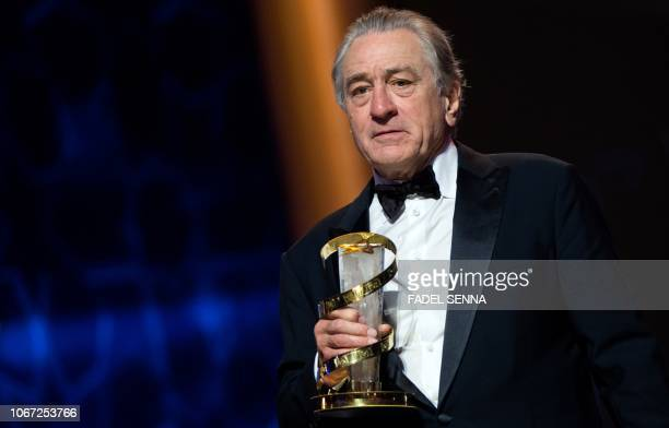 US actor Robert de Niro poses with a Tribute award during the 17th Marrakech International Film Festival on December 1 2018