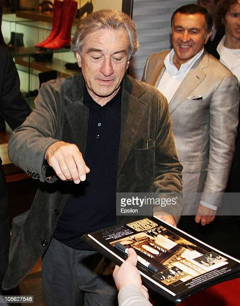 US actor Robert De Niro signs autographs during the 'Stone' Russian Premiere in Luxor Vegas Cinema Hall on October 16 2010 in Moscow Russia