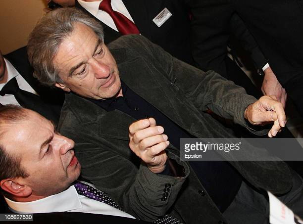 US actor Robert De Niro signs his star during the 'Stone' Russian Premiere in Luxor Vegas Cinema Hall on October 16 2010 in Moscow Russia