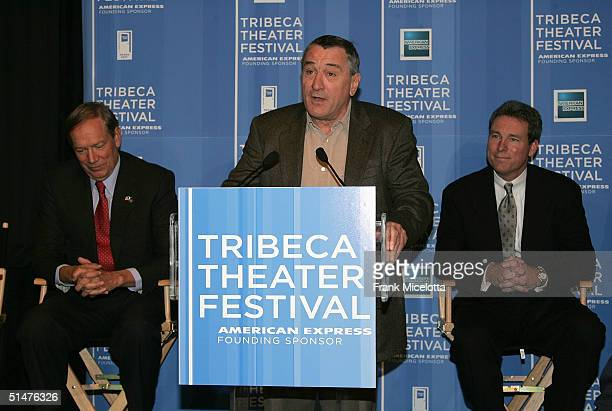 Actor Robert De Niro speaks as New York Governor George Pataki and Chief Marketing Officer of American Express John Hayes look on at the press...
