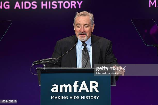 Actor Robert De Niro speaks on stage at the 2016 amfAR New York Gala at Cipriani Wall Street on February 10 2016 in New York City