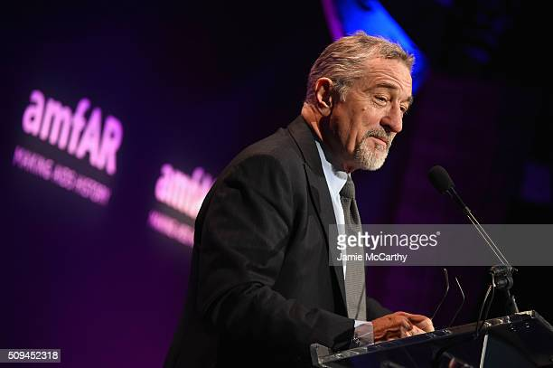 Actor Robert De Niro speaks onstage during the 2016 amfAR New York Gala at Cipriani Wall Street on February 10 2016 in New York City