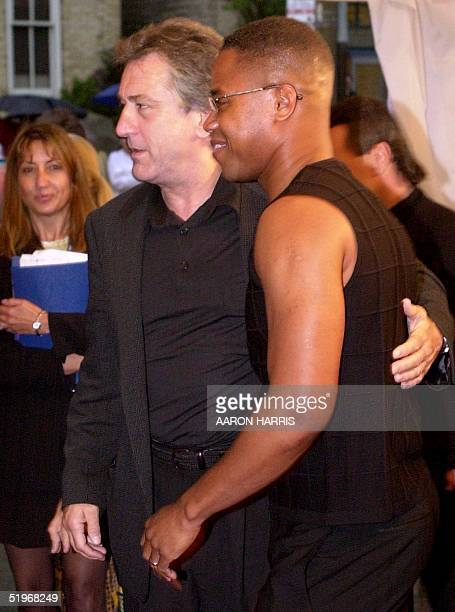 US actor Robert DeNiro and Cuba Gooding Jr pose for photographers as they arrive for the Toronto International Film Festival screening of 'Men of...