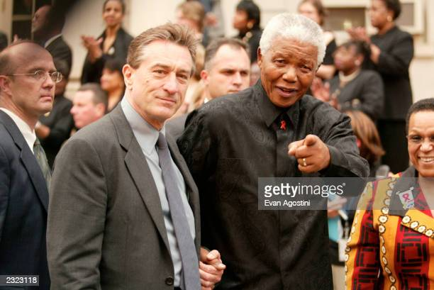 Actor Robert DeNiro and Nelson Mandela at the official opening night ceremony of the Tribeca Film Festival at City Hall in New York City May 8 2002...