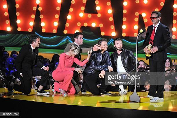 Actor Robert Downey Jr accepts the MTV Generation Award from actors Mark Ruffalo Scarlett Johansson Chris Hemsworth Jeremy Renner and Chris Evans...