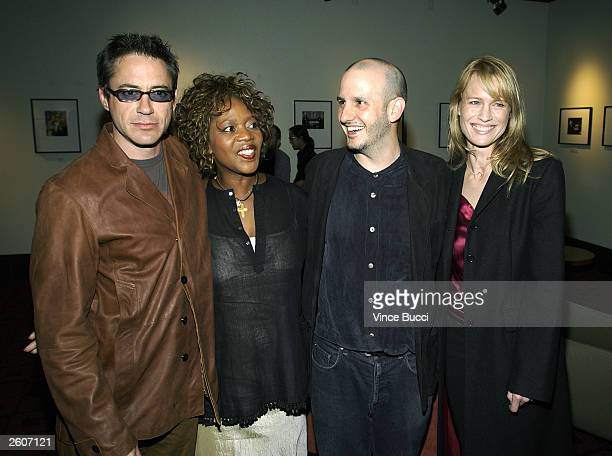 Actor Robert Downey Jr actress Alfre Woodard director Keith Gordon and actress Robin Wright Penn attend the premiere of the film The Singing...