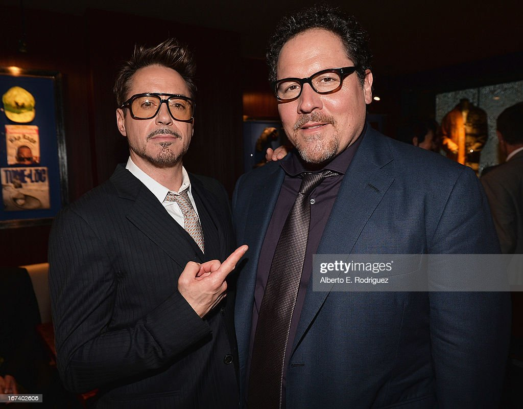 Actor Robert Downey Jr. and actor/producer Jon Favreau attend Marvel's Iron Man 3 Premiere after party at Hard Rock Cafe on April 24, 2013 in Hollywood, California.