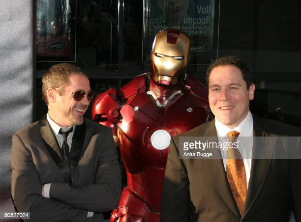 Actor Robert Downey Jr. And Director Jon Favreau attend the premiere for the movie 'Iron Man' at the Cinemaxx on April 22, 2008 in Berlin, Germany.