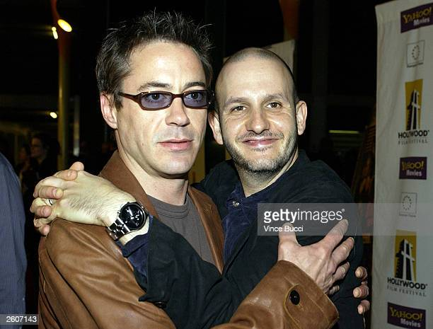 Actor Robert Downey Jr and director Keith Gordon attend the premiere of the film The Singing Detective during the Hollywood Film Festival on October...