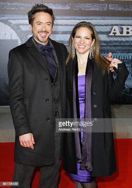 Actor Robert Downey Jr and his wife and producer Susan Downey attend the 'Sherlock Holmes' German Premiere at CineStar on January 12 2010 in Berlin...