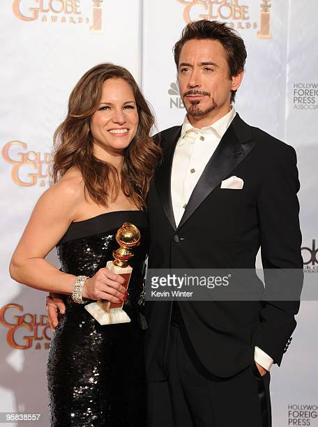 Actor Robert Downey Jr and his wife Susan with the Best Performance by an Actor in a Motion Picture Comedy Or Musical award for Sherlock Holmes in...
