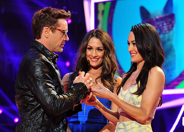 Actor Robert Downey Jr and professional wrestlers Nicole GarciaColace and Brianna GarciaColace onstage at Nickelodeon's 27th Annual Kids' Choice...