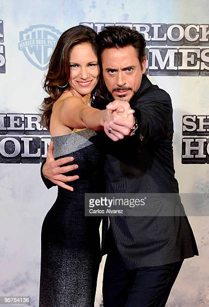 """Actor Robert Downey Jr and wife producer Susan Downey attends """"Sherlock Holmes"""" premiere at Kinepolis cinema on January 13, 2010 in Madrid, Spain."""