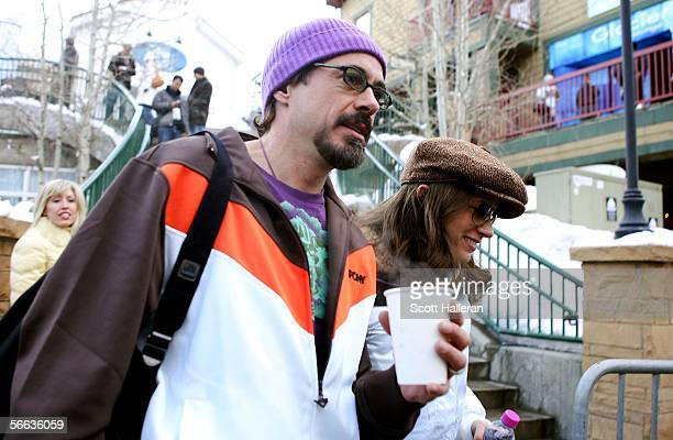 Actor Robert Downey Jr and wife producer Susan Levin walk on Main Street during the 2006 Sundance Film Festival January 20 2006 in Park City Utah