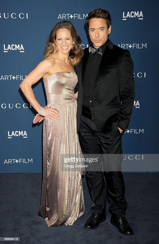 Actor Robert Downey Jr. and wife Susan Downey arrive at the LACMA 2013 Art + Film Gala at LACMA on November 2, 2013 in Los Angeles, California.