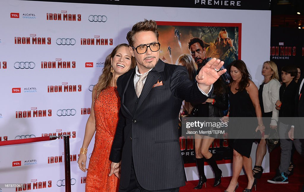 Actor Robert Downey Jr. (R) and wife Susan Downey attend the premiere of Walt Disney Pictures' 'Iron Man 3' at the El Capitan Theatre on April 24, 2013 in Hollywood, California.