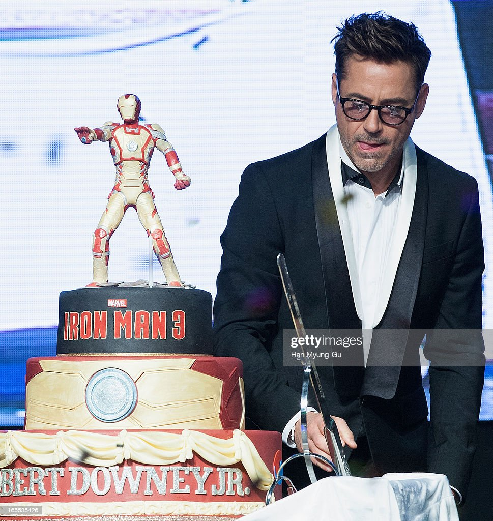 Actor Robert Downey Jr. cuts his 48th birthday cake during the 'Iron Man 3' South Korea Premiere at Times Square on April 4, 2013 in Seoul, South Korea. Robert Downey Jr. is visiting South Korea to promote his recent film 'Iron Man 3' which will be released on April 25 in South Korea.