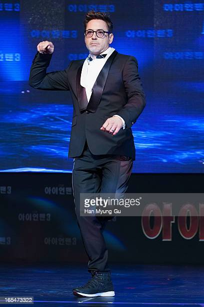 Actor Robert Downey Jr dances to a song by South Korean rapper Psy during the 'Iron Man 3' South Korea Premiere at Times Square on April 4 2013 in...